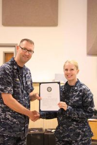 Accepting my Bluejacket of the Quarter commendation letter